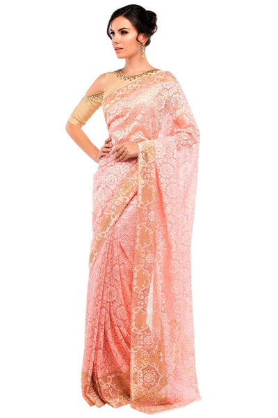 Buy peach color floral pattern lace saree with blouse piece online in USA at Pure Elegance online store. Give yourself a brilliant makeover with a range of exquisite Indian designer sarees from our clothing store in USA. Choose as per your taste whether it is wedding sarees, traditional silk sarees, handloom sarees we have got all under one roof. -front