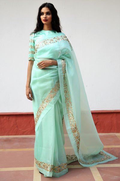 Buy mint green embroidered silk organza saree online in USA with blouse. Get party ready with a stunning range of Indian designer sarees from Pure Elegance fashion store in USA. Shop from a collection of silk sarees, wedding sarees, Banarasi sarees, and Indian clothing for a gorgeous ethnic look.-full view
