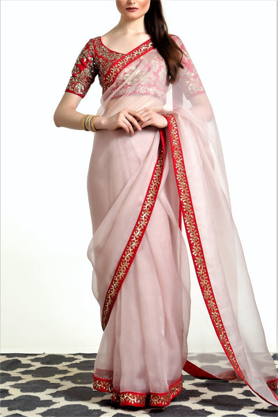 Shop powder pink embroidered organza silk saree online in USA with blouse. Get party ready with a stunning range of Indian designer sarees from Pure Elegance fashion store in USA. Shop from a collection of silk sarees, wedding sarees, Banarasi sarees, and Indian clothing for a gorgeous ethnic look.-full view