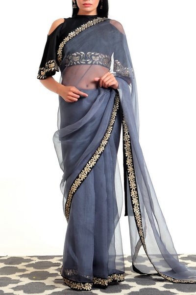 Buy grey embroidered organza silk sari online in USA with cold shoulder blouse. Get party ready with a stunning range of Indian designer saris with blouses from Pure Elegance fashion store in USA. Shop from a collection of silk sarees, wedding sarees, Banarasi sarees, and Indian clothing for a gorgeous ethnic look.-full view