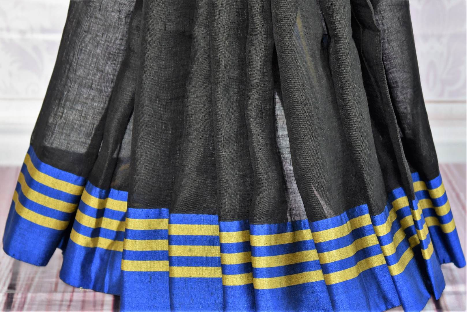 Buy black and grey linen saree with Banarasi blouse online in USA. Find an exquisite range of pure handloom sarees in USA at Pure Elegance Indian clothing store. Enhance your ethnic look with a variety of silk sarees, Banarasi saris, Kanchipuram, and Indian jewelry available at our online store.-pleats