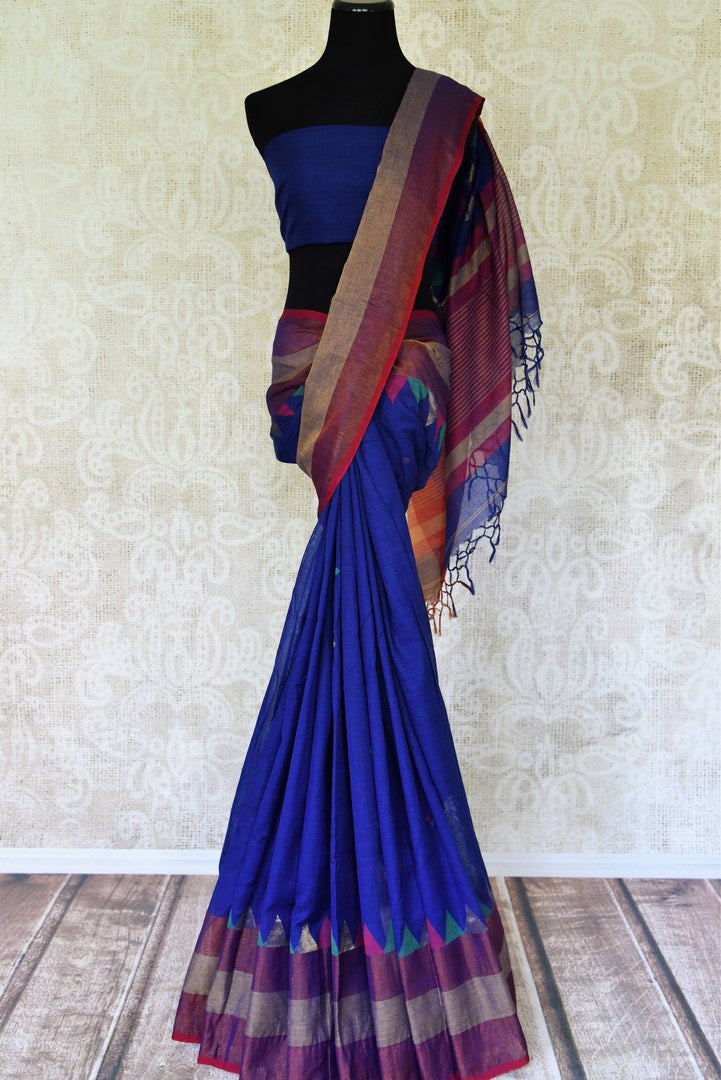 Blue matka cotton saree for online shopping in USA from Pure Elegance online store. Visit our exclusive Indian clothing store in USA and get floored by a range of exquisite Indian sarees, handloom sarees, silk sarees, Indian jewelry and much more to complete your ethnic look.-full view