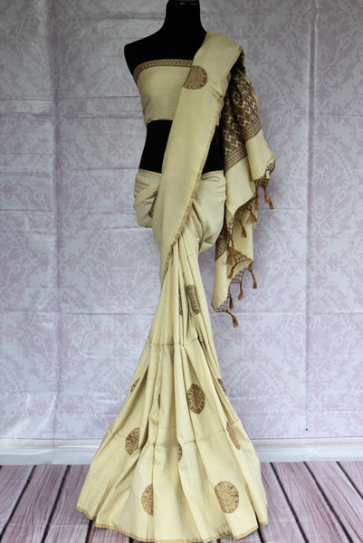 Buy elegant off-white Muga Benarasi saree online in USA. Find an exquisite range of pure handloom sarees in USA at Pure Elegance Indian clothing store. Enhance your ethnic look with a variety of silk sarees, Banarasi saris, Kanchipuram, and Indian jewelry available at our online store.-full view