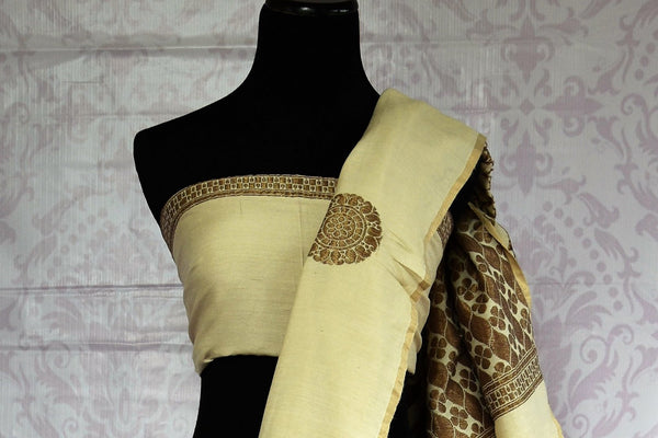 Buy elegant off-white Muga Benarasi saree online in USA. Find an exquisite range of pure handloom sarees in USA at Pure Elegance Indian clothing store. Enhance your ethnic look with a variety of silk sarees, Banarasi saris, Kanchipuram, and Indian jewelry available at our online store.-blouse pallu
