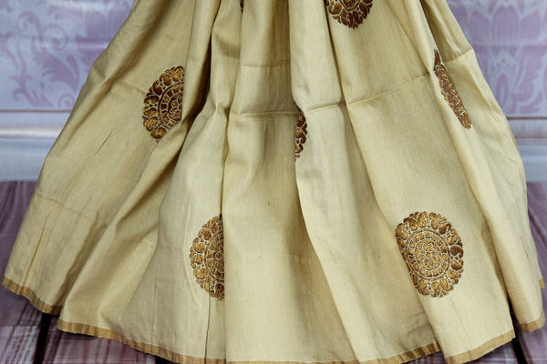 Buy elegant off-white Muga Benarasi saree online in USA. Find an exquisite range of pure handloom sarees in USA at Pure Elegance Indian clothing store. Enhance your ethnic look with a variety of silk sarees, Banarasi saris, Kanchipuram, and Indian jewelry available at our online store.-pleats
