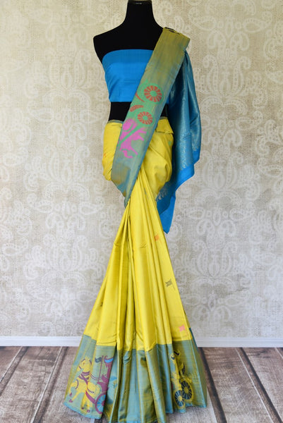 Buy lemon yellow Kanjeevaram saree online in USA with greenish blue border. For Indian women in USA, Pure Elegance fashion store brings a stunning range of traditional Indian Kanchipuram saris in alluring designs for a rich ethnic style. We also have a range of designer silk sarees, wedding sarees, embroidered saris, Indian clothing at our online store.-full view
