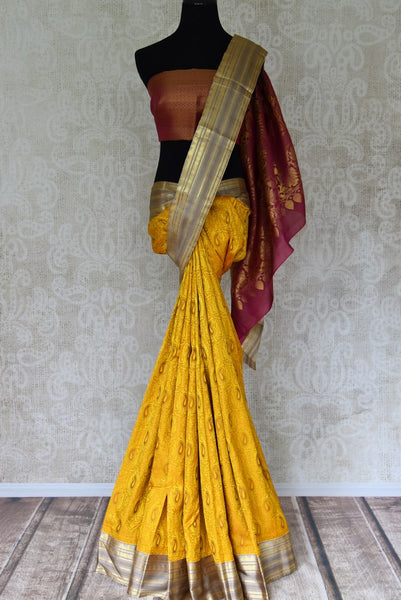 Yellow Kanchipuram saree with golden border for online shopping in USA from Pure Elegance online store. Visit our exclusive Indian clothing store in USA and get floored by a range of exquisite Indian Kanjivaram sarees, handloom sarees, silk sarees, Indian jewelry and much more to complete your ethnic look.-full view
