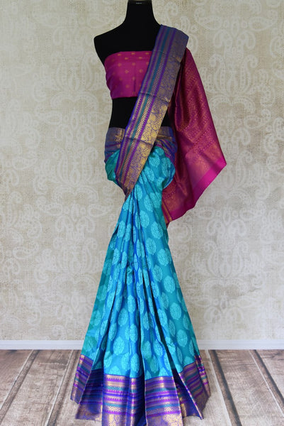 Blue Kanjivaram saree with zari border for online shopping in USA from Pure Elegance online store. Visit our exclusive Indian clothing store in USA and get floored by a range of exquisite Indian Kanjivaram saris, handloom sarees, silk sarees, Indian jewelry and much more to complete your ethnic look.-full view