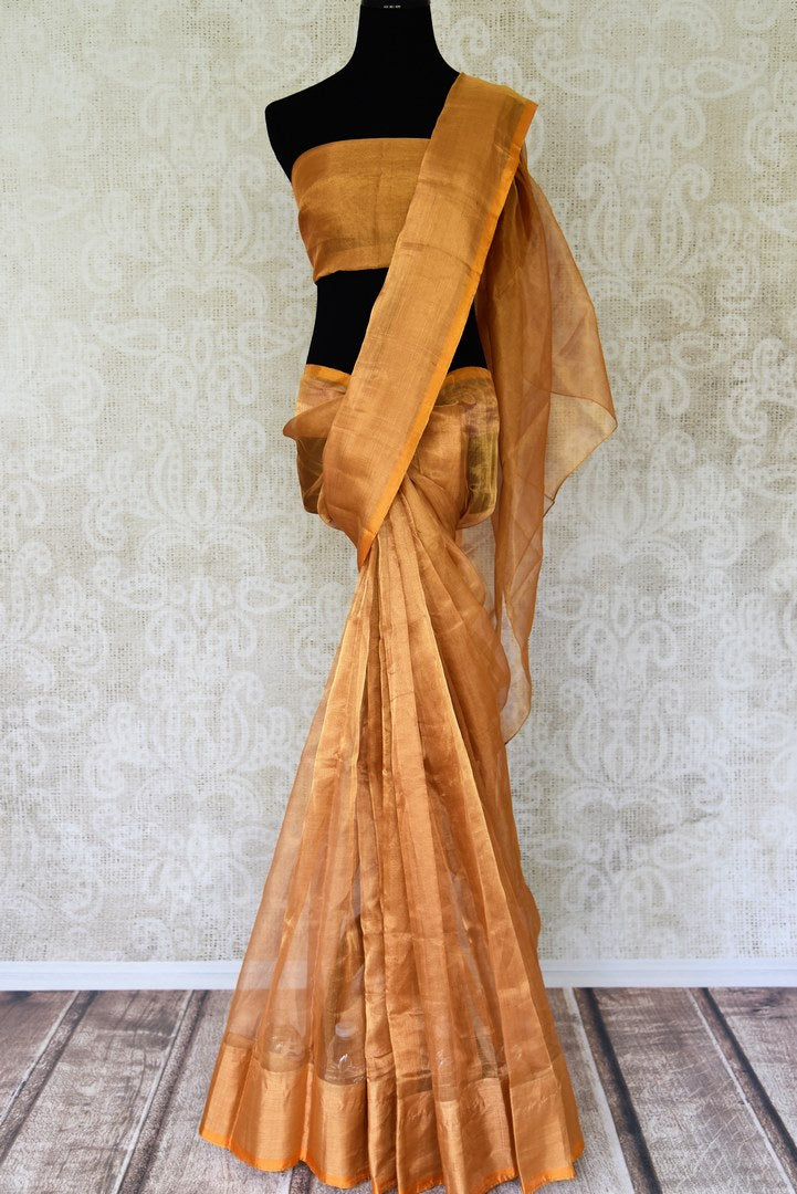 Shop handwoven golden Uppada saree online in USA  from Pure Elegance online store. Visit our exclusive Indian clothing store in USA and get floored by a range of exquisite Indian Kanjivaram saris, handloom sarees, silk sarees, Indian jewelry and much more to complete your ethnic look.-full view