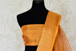 Shop handwoven golden Uppada saree online in USA  from Pure Elegance online store. Visit our exclusive Indian clothing store in USA and get floored by a range of exquisite Indian Kanjivaram saris, handloom sarees, silk sarees, Indian jewelry and much more to complete your ethnic look.-blouse pallu