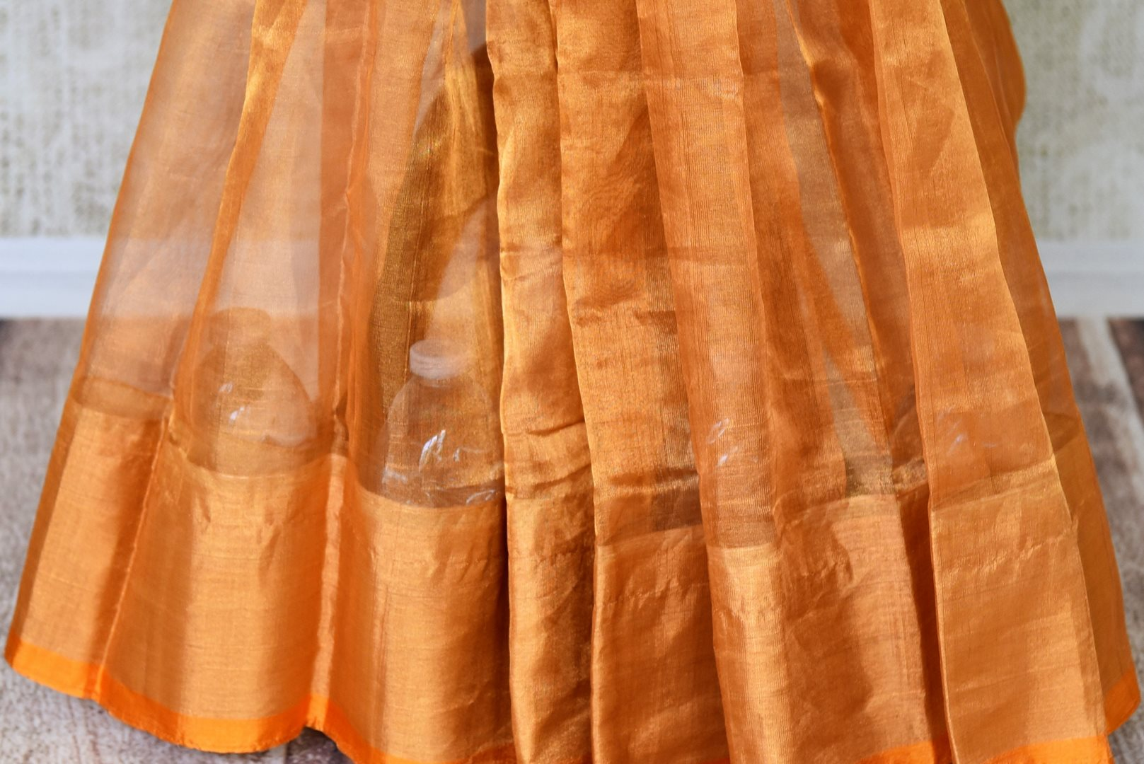Shop handwoven golden Uppada saree online in USA  from Pure Elegance online store. Visit our exclusive Indian clothing store in USA and get floored by a range of exquisite Indian Kanjivaram saris, handloom sarees, silk sarees, Indian jewelry and much more to complete your ethnic look.-pleats