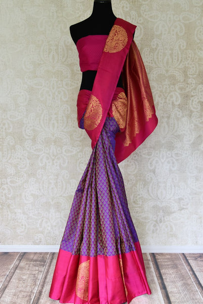 Buy purple Kanchipuram saree online in USA with pink border from Pure Elegance online store. Visit our exclusive Indian clothing store in USA and get floored by a range of exquisite Indian Kanjivaram saris, handloom sarees, silk sarees, Indian jewelry and much more to complete your ethnic look.-full view