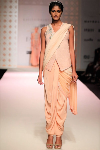 Buy peach color draped dhoti saree online in USA with embroidered jacket. Make a captivating fashion statement with a range of Indian designer sarees from Pure Elegance clothing store in USA. If you are looking for online saree shopping, then look to our online store for a stunning collection of pure silk sarees, bridal sarees and much more.-full view