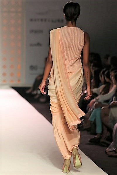 Buy peach color draped dhoti saree online in USA with embroidered jacket. Make a captivating fashion statement with a range of Indian designer sarees from Pure Elegance clothing store in USA. If you are looking for online saree shopping, then look to our online store for a stunning collection of pure silk sarees, bridal sarees and much more.-back