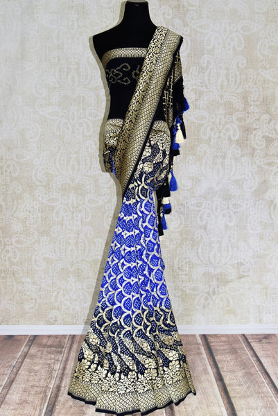 Buy blue and black Benarasi sari online in USA with overall zari and bandhej jaal from Pure Elegance online store. Visit our exclusive Indian clothing store in USA and get floored by a range of exquisite Indian Kanjivaram saris, Banarasi sarees, silk sarees, Indian jewelry and much more to complete your ethnic look.-full view