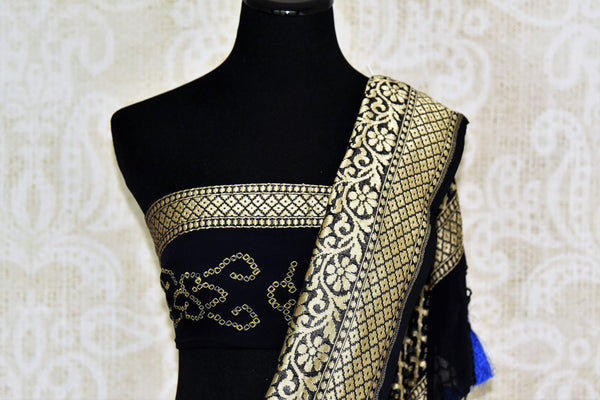 Buy blue and black Benarasi sari online in USA with overall zari and bandhej jaal from Pure Elegance online store. Visit our exclusive Indian clothing store in USA and get floored by a range of exquisite Indian Kanjivaram saris, Banarasi sarees, silk sarees, Indian jewelry and much more to complete your ethnic look.-blouse pallu