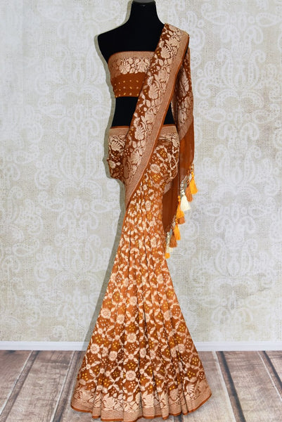 Buy brown color Benarasi saree online in USA with overall zari and bandhej jaal from Pure Elegance online store. Visit our exclusive Indian clothing store in USA and get floored by a range of exquisite Indian Kanjivaram saris, Banarasi sarees, silk sarees, Indian jewelry and much more to complete your ethnic look.-full view