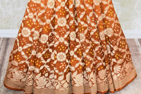 Buy brown color Benarasi saree online in USA with overall zari and bandhej jaal from Pure Elegance online store. Visit our exclusive Indian clothing store in USA and get floored by a range of exquisite Indian Kanjivaram saris, Banarasi sarees, silk sarees, Indian jewelry and much more to complete your ethnic look.-pleats
