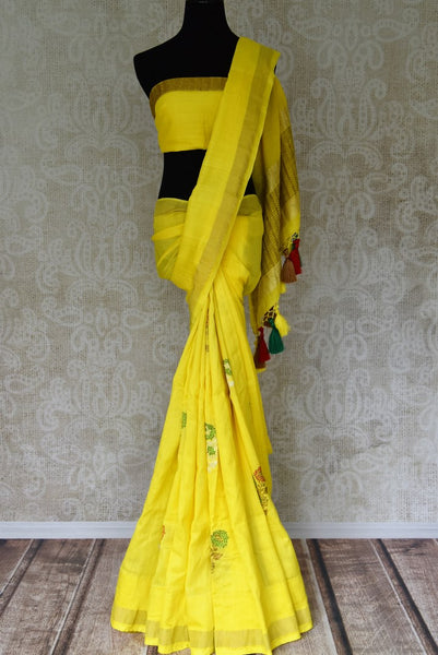 Shop bright yellow muga Banarasi saree online in USA with floral buta from Pure Elegance online store. Visit our exclusive Indian clothing store in USA and get floored by a range of exquisite Indian Kanjivaram saris, Banarasi sarees, silk sarees, Indian jewelry and much more to complete your ethnic look.-full view