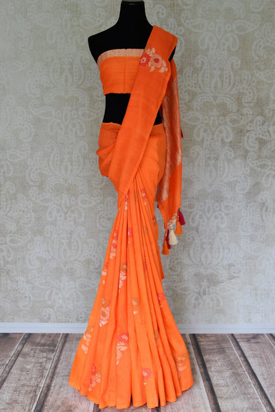 Shop beautiful orange muga Banarasi saree online in USA with floral buta from Pure Elegance online store. Visit our exclusive Indian clothing store in USA and get floored by a range of exquisite Indian Kanjivaram saris, Banarasi sarees, silk sarees, Indian jewelry and much more to complete your ethnic look.-full view