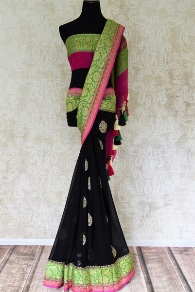 Shop black georgette Benarasi sari online in USA with green pink floral zari border from Pure Elegance online store. Visit our exclusive Indian clothing store in USA and get floored by a range of exquisite pure handloom sarees, Banarasi sarees, silk sarees, Indian jewelry and much more to complete your ethnic look.-full view