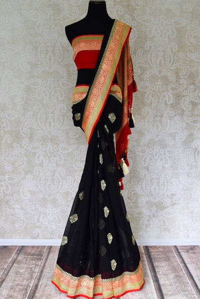 Buy stunning black georgette Benarasi saree online in USA with red floral zari border from Pure Elegance online store. Visit our exclusive Indian clothing store in USA and get floored by a range of exquisite pure handloom sarees, Banarasi sarees, silk sarees, Indian jewelry and much more to complete your ethnic look.-full view