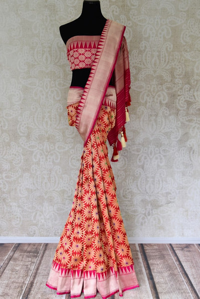 Buy red Benarasi silk saree online in USA with overall floral zari work from Pure Elegance online store. Visit our exclusive Indian clothing store in USA and get floored by a range of exquisite pure handloom sarees, Banarasi sarees, silk sarees, Indian jewelry and much more to complete your ethnic look.-full view