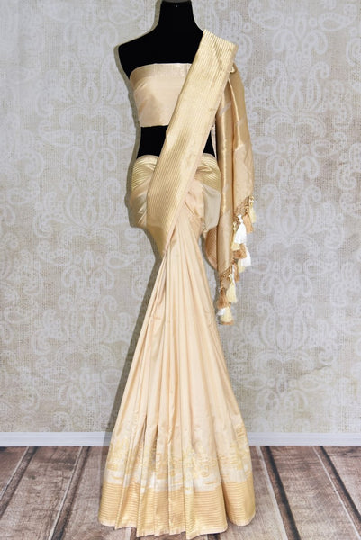 Buy cream color Banarasi silk saree online in USA with Banaras ghat zari border from Pure Elegance online store. Visit our exclusive Indian clothing store in USA and get floored by a range of exquisite Indian Kanjivaram saris, Banarasi sarees, silk sarees, Indian jewelry and much more to complete your ethnic look.-full view