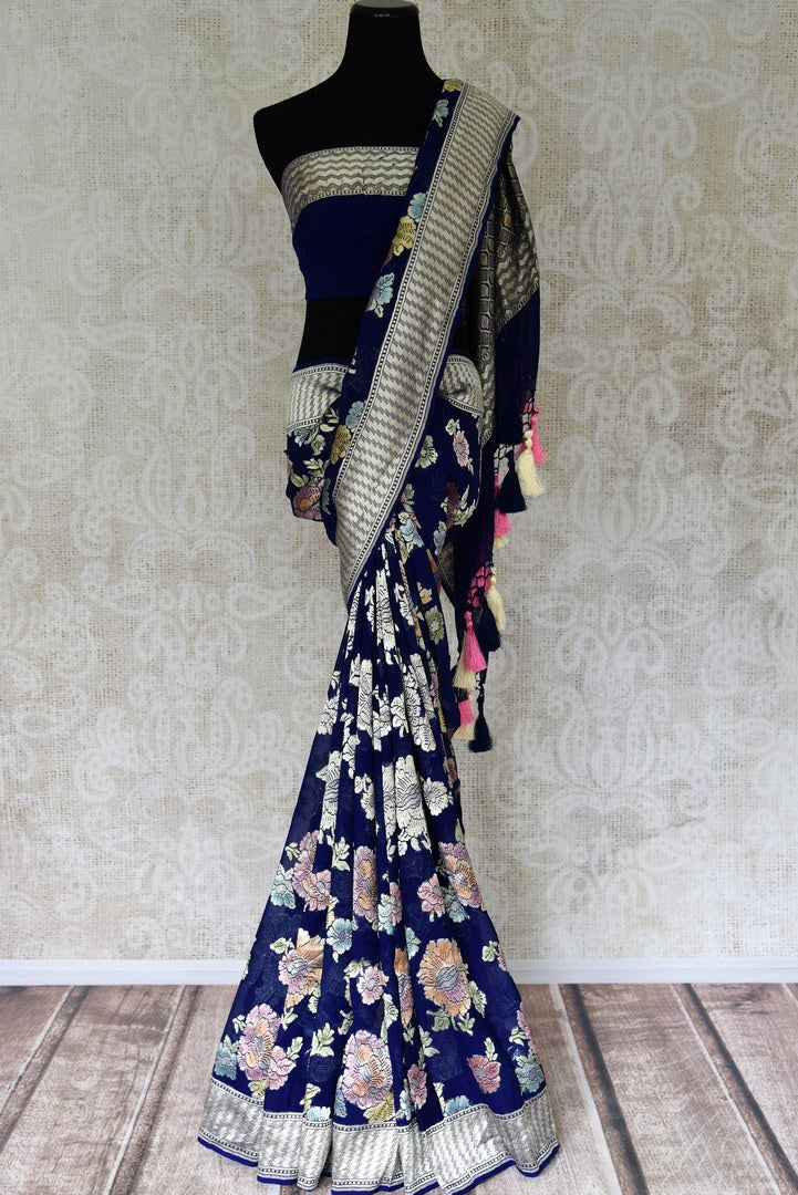 Buy dark blue georgette Benarasi saree online in USA with overall floral zari jaal from Pure Elegance online store. Visit our exclusive Indian clothing store in USA and get floored by a range of exquisite pure handloom sarees, Banarasi sarees, silk sarees, Indian jewelry and much more to complete your ethnic look.-full view