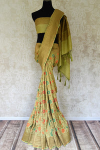 Shop green color muga Banarasi saree online in USA with floral zari and minakari work from Pure Elegance online store. Visit our exclusive Indian clothing store in USA and get floored by a range of exquisite pure handloom sarees, Banarasi sarees, silk sarees, Indian jewelry and much more to complete your ethnic look.-full view