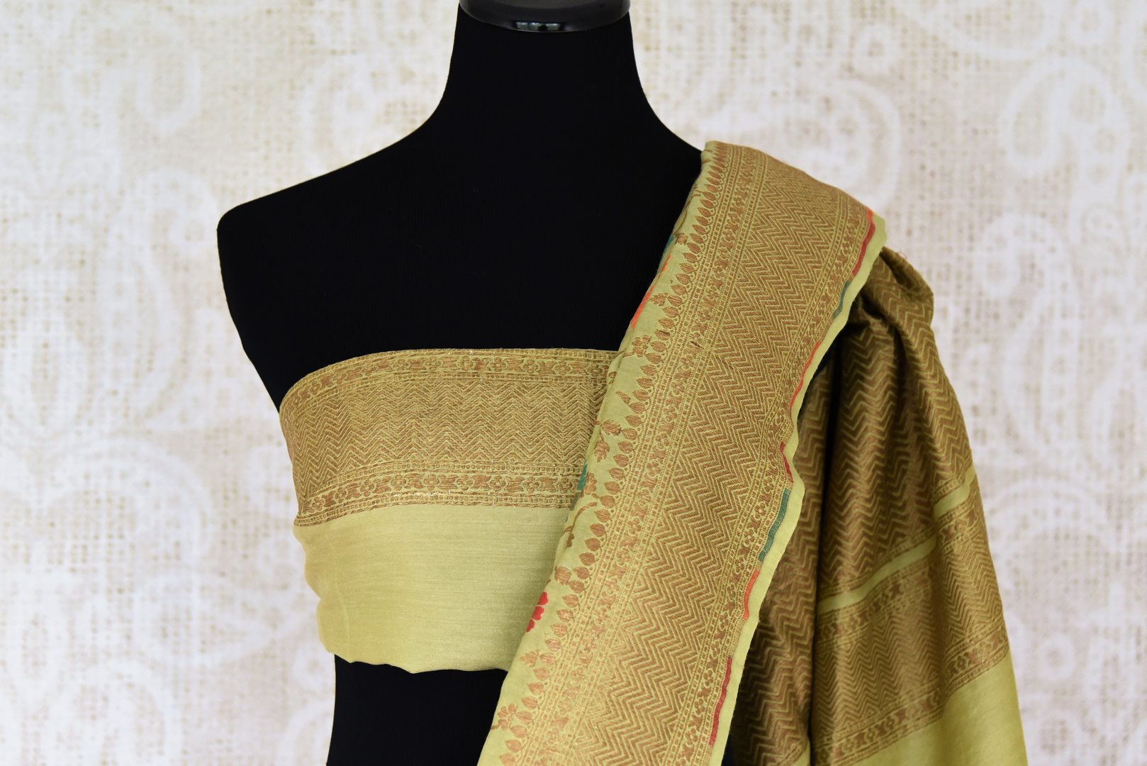 Shop green color muga Banarasi saree online in USA with floral zari and minakari work from Pure Elegance online store. Visit our exclusive Indian clothing store in USA and get floored by a range of exquisite pure handloom sarees, Banarasi sarees, silk sarees, Indian jewelry and much more to complete your ethnic look.-blouse pallu