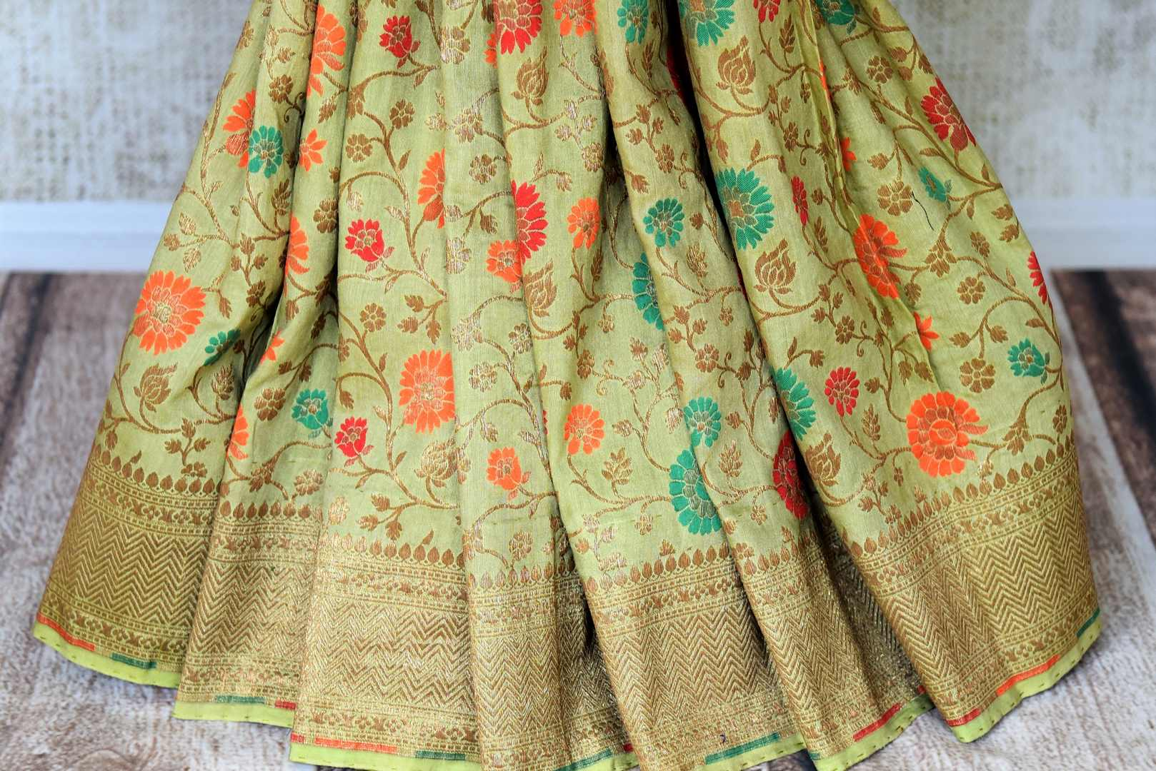 Shop green color muga Banarasi saree online in USA with floral zari and minakari work from Pure Elegance online store. Visit our exclusive Indian clothing store in USA and get floored by a range of exquisite pure handloom sarees, Banarasi sarees, silk sarees, Indian jewelry and much more to complete your ethnic look.-pleats