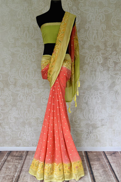 Shop coral color Banarasi georgette sari online in USA with green zari border from Pure Elegance online store. Visit our exclusive Indian fashion store in USA and get floored by a range of exquisite pure handloom sarees, Banarasi sarees, silk sarees, Indian jewelry and much more to complete your ethnic look.-full view