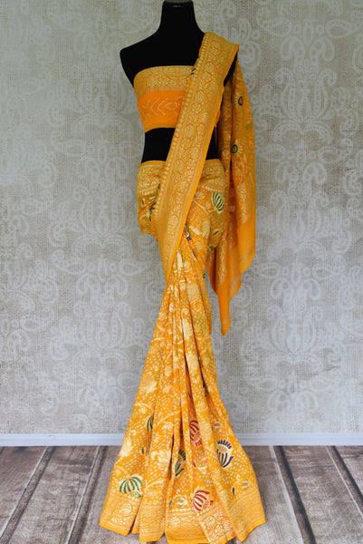 Gorgeous yellow georgette Banarasi saree for online shopping in USA. Shop stunning Banarasi sarees in USA from Pure Elegance online store. Explore a world of Indian designer sarees, wedding sarees, pure silk sarees, embroidered saris and much more at our exclusive Indian clothing store in USA.-full view