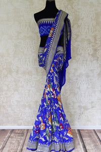 Blue color georgette Banarasi saree with bandhej print for online shopping in USA. Shop stunning Banarasi saris in USA from Pure Elegance online store. Explore a world of Indian designer sarees, wedding sarees, pure silk sarees, embroidered saris and much more at our exclusive Indian clothing store in USA.-full view
