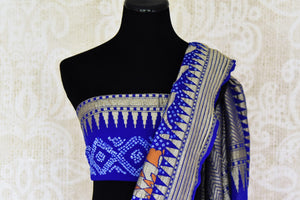 Blue color georgette Banarasi saree with bandhej print for online shopping in USA. Shop stunning Banarasi saris in USA from Pure Elegance online store. Explore a world of Indian designer sarees, wedding sarees, pure silk sarees, embroidered saris and much more at our exclusive Indian clothing store in USA.-blouse pallu