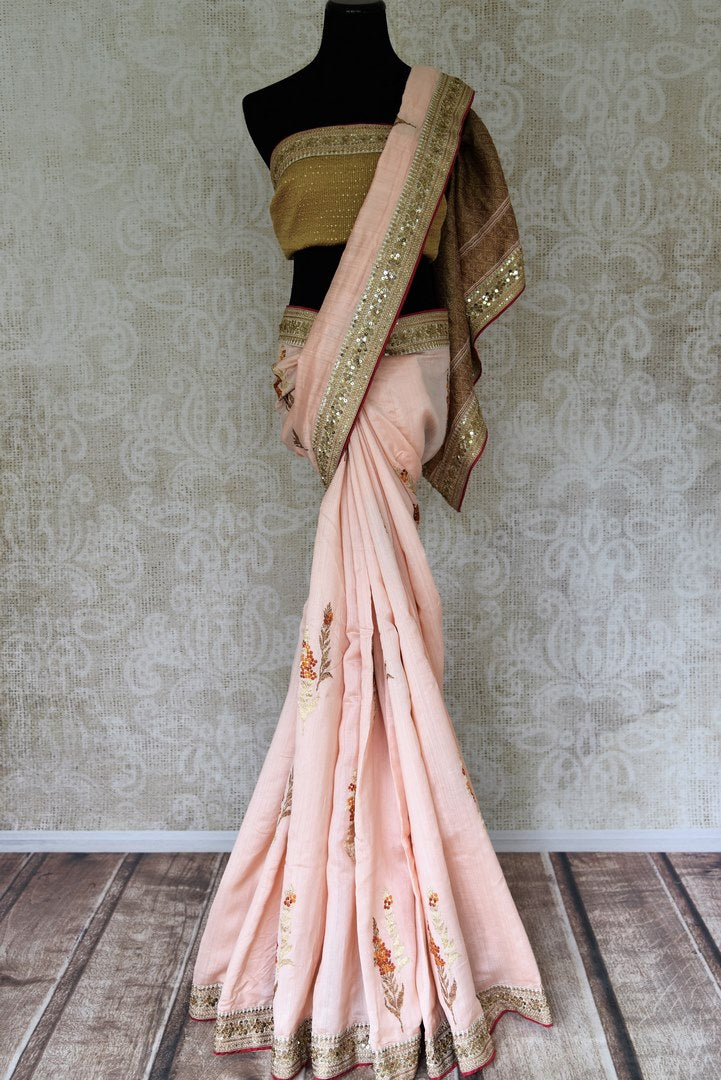 Powder pink muga Banarasi saree with embroidered border for online shopping in USA. Shop stunning Banarasi saris in USA from Pure Elegance online store. Explore a world of Indian designer sarees, wedding sarees, pure silk sarees, embroidered saris and much more at our exclusive Indian clothing store in USA.-full view