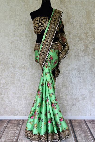 Shop green embroidered crepe sari online in USA with floral print. Shop traditional Indian sarees in USA from Pure Elegance online store. Explore a world of designer sarees, wedding sarees, embroidered saris and much more at our exclusive Indian clothing store in USA.-full view