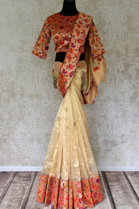Buy gold color tissue silk saree with bright floral border online in USA. Shop stunning Banarasi saris in USA from Pure Elegance online store. Explore a world of Indian designer sarees, wedding sarees, pure silk sarees, embroidered saris and much more at our exclusive Indian clothing store in USA.-full view