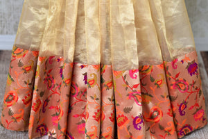 Buy gold color tissue silk saree with bright floral border online in USA. Shop stunning Banarasi saris in USA from Pure Elegance online store. Explore a world of Indian designer sarees, wedding sarees, pure silk sarees, embroidered saris and much more at our exclusive Indian clothing store in USA.-pleats