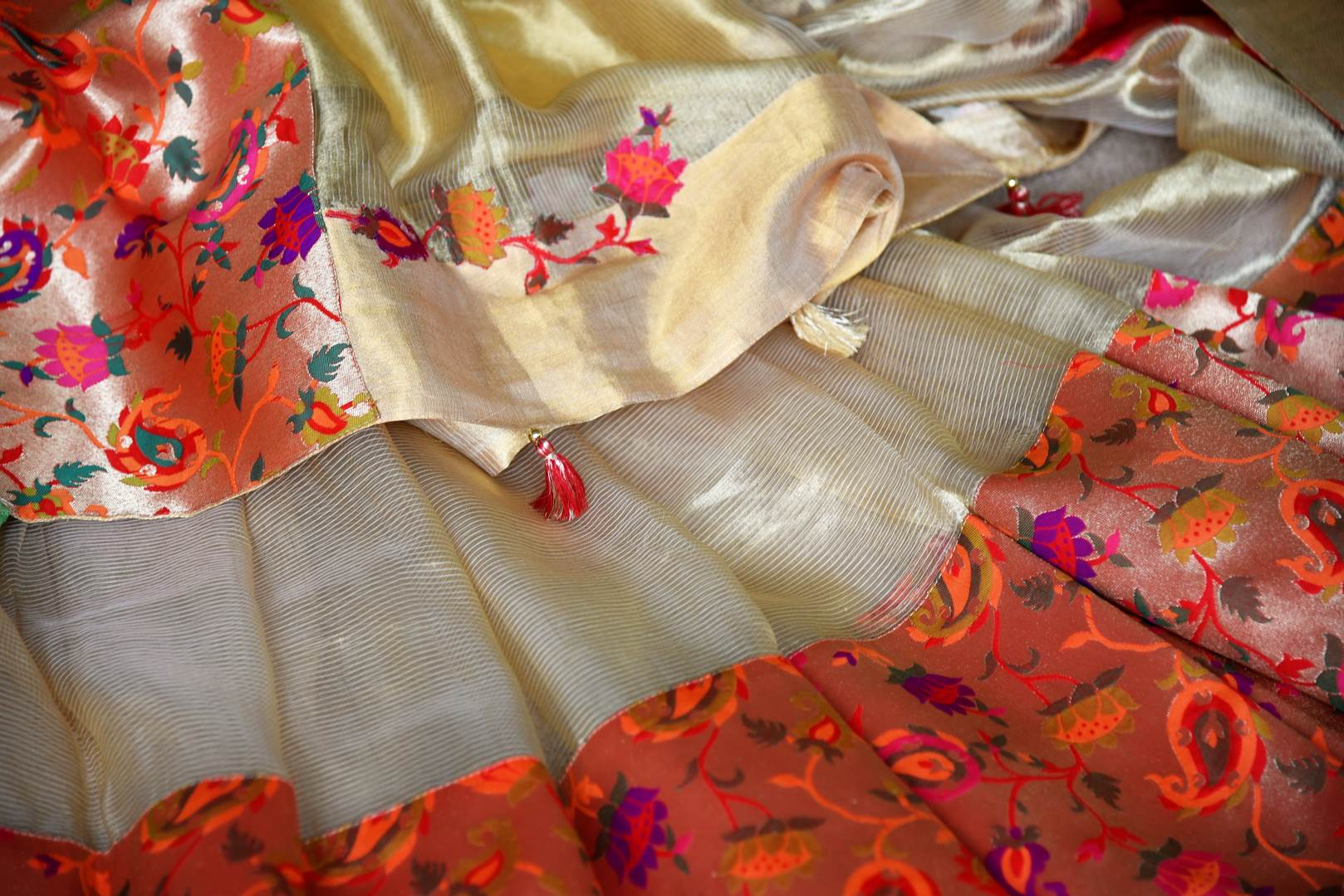Buy gold color tissue silk saree with bright floral border online in USA. Shop stunning Banarasi saris in USA from Pure Elegance online store. Explore a world of Indian designer sarees, wedding sarees, pure silk sarees, embroidered saris and much more at our exclusive Indian clothing store in USA.-details