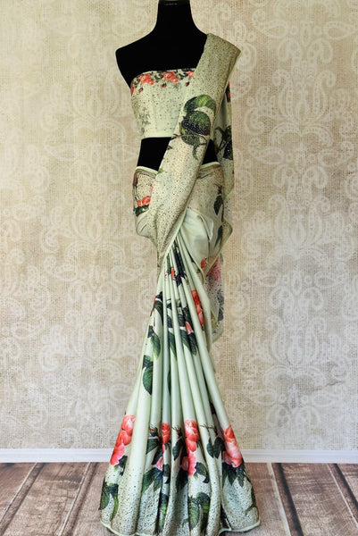 Buy pastel green floral print crepe sari online in USA with swarovski work. Shop traditional Indian sarees in USA from Pure Elegance online store. Explore a world of designer sarees, wedding sarees, embroidered saris and much more at our exclusive Indian clothing store in USA.-full view