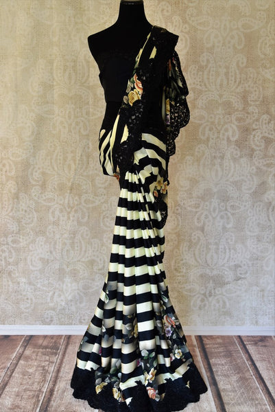 Buy black and white striped crepe saree online in USA with lace embroidery. Shop traditional Indian sarees in USA from Pure Elegance online store. Explore a world of designer sarees, wedding sarees, embroidered saris and much more at our exclusive Indian clothing store in USA.-full view