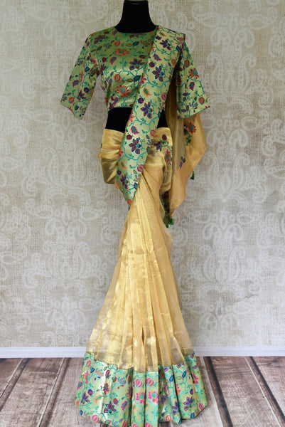 Buy gold tissue silk saree with saree blouse online in USA. Shop stunning Banarasi sarees in USA from Pure Elegance online store. Explore a world of Indian designer sarees, wedding sarees, pure silk sarees, embroidered saris and much more at our exclusive Indian clothing store in USA.-full view