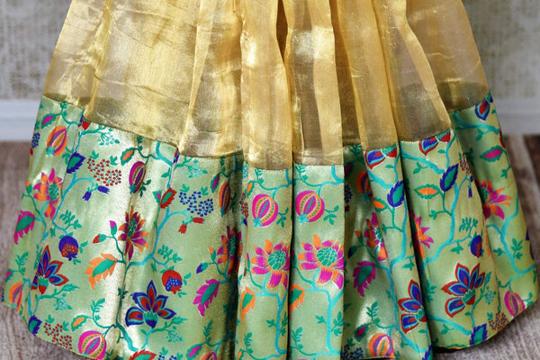 Buy gold tissue silk saree with saree blouse online in USA. Shop stunning Banarasi sarees in USA from Pure Elegance online store. Explore a world of Indian designer sarees, wedding sarees, pure silk sarees, embroidered saris and much more at our exclusive Indian clothing store in USA.-pleats