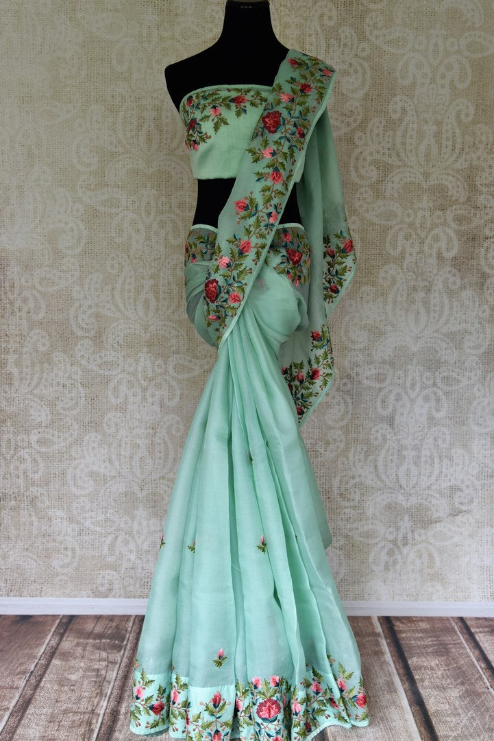 Shop beautiful pastel green embroidered organza sari online in USA from Pure Elegance. Be occasion ready always with a range of beautiful traditional handwoven sarees, pure silk sarees, Banarasi saris, Kanchipuram sarees available at our Indian fashion store in USA. Grab your favorite pieces now also available at our online store.-full view