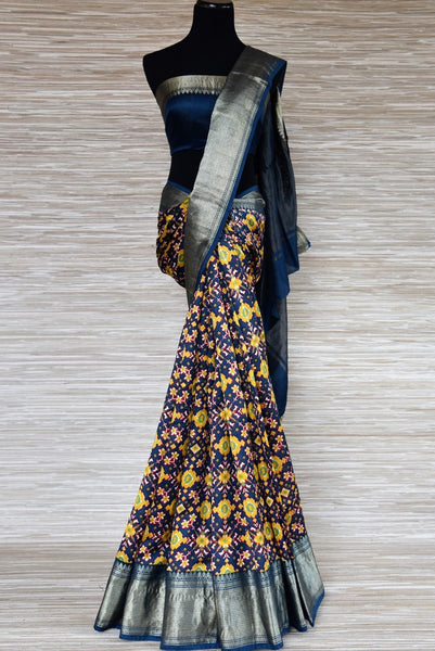 Buy blue printed mulberry silk sari online in USA with silver zari border from Pure Elegance. Be an epitome of Indian fashion with an exquisite variety of Indian handloom saris, pure silk sarees, Bollywood sarees from our exclusive fashion store in USA.-full view