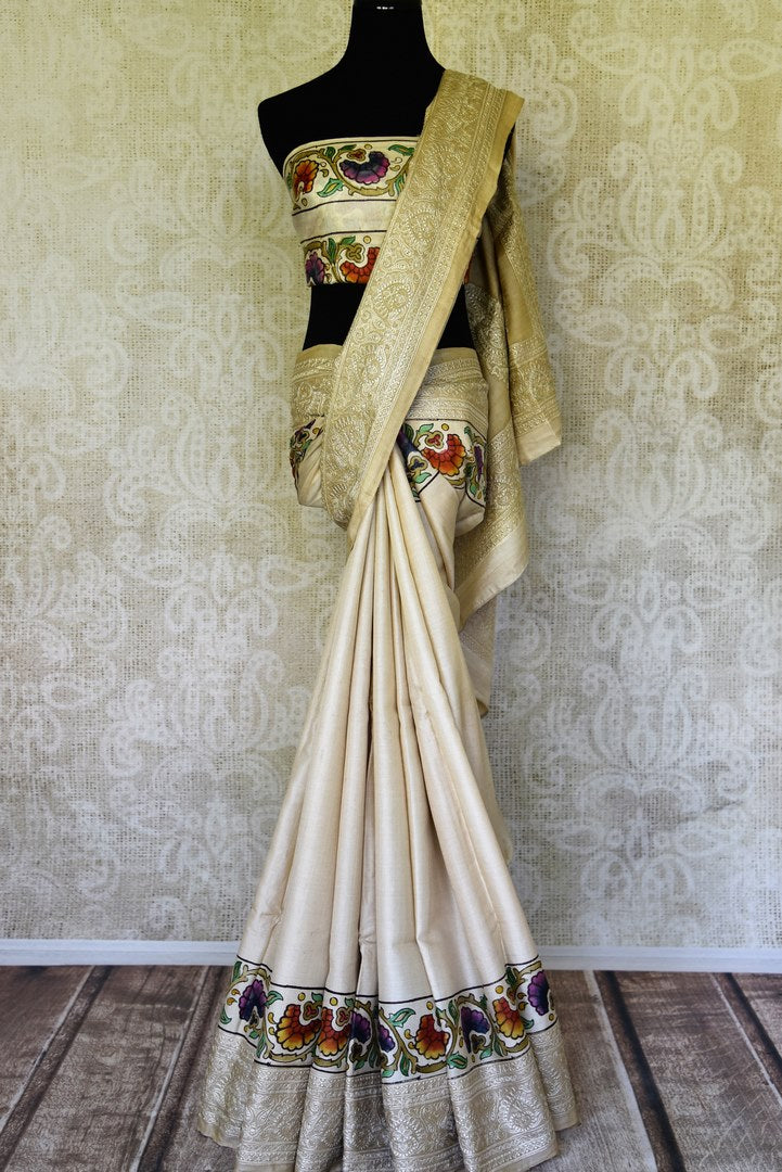 Buy cream tussar silk handprinted and embroidered saree online in USA. Find a splendid collection of Indian designer sarees with blouses in USA at Pure Elegance Indian clothing store. Make a striking appearance on festive occasions by shopping from a range of pure silk saris, Banarasi sarees, embroidered saris from our online store.-full view
