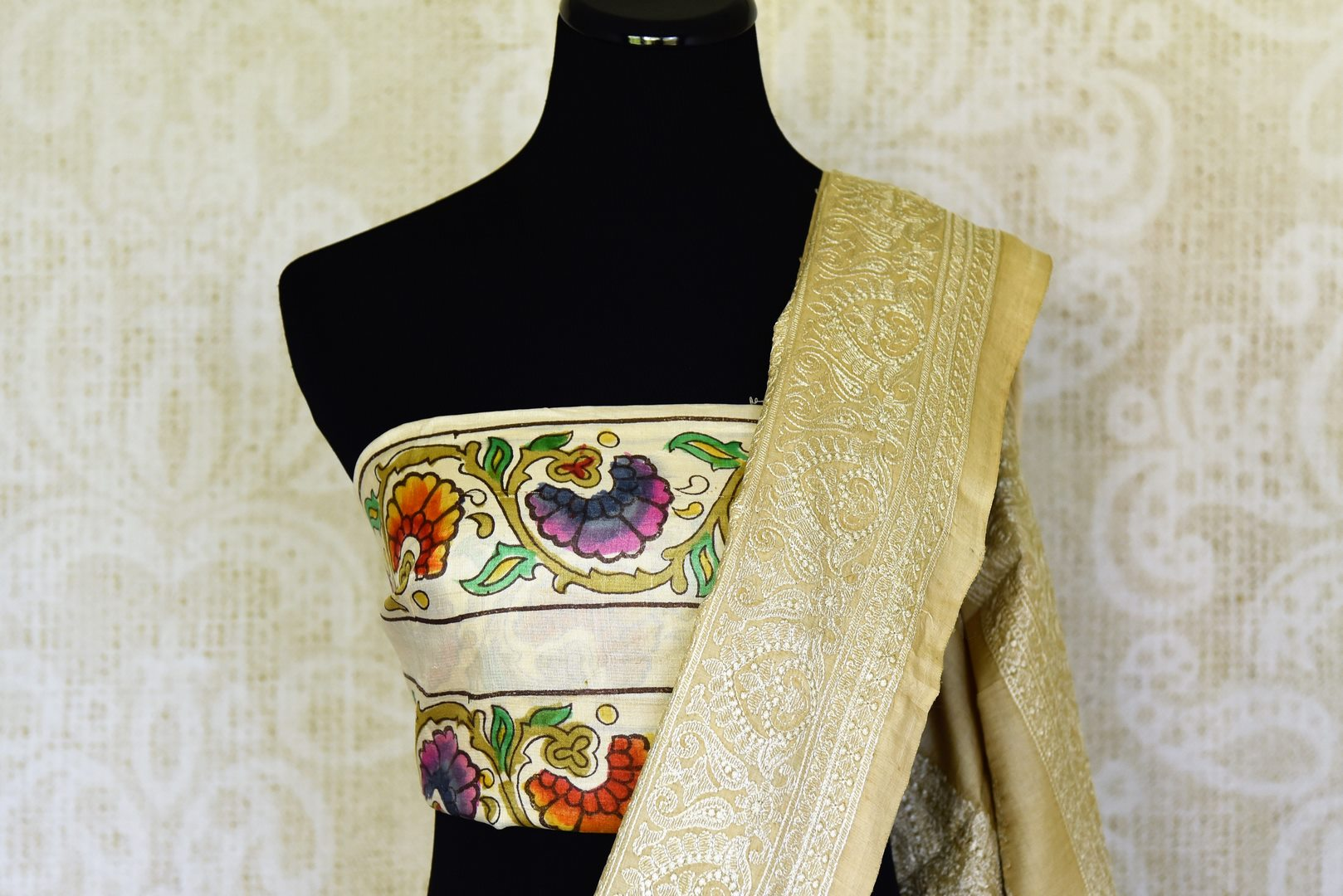 Buy cream tussar silk handprinted and embroidered saree online in USA. Find a splendid collection of Indian designer sarees with blouses in USA at Pure Elegance Indian clothing store. Make a striking appearance on festive occasions by shopping from a range of pure silk saris, Banarasi sarees, embroidered saris from our online store.-blouse pallu