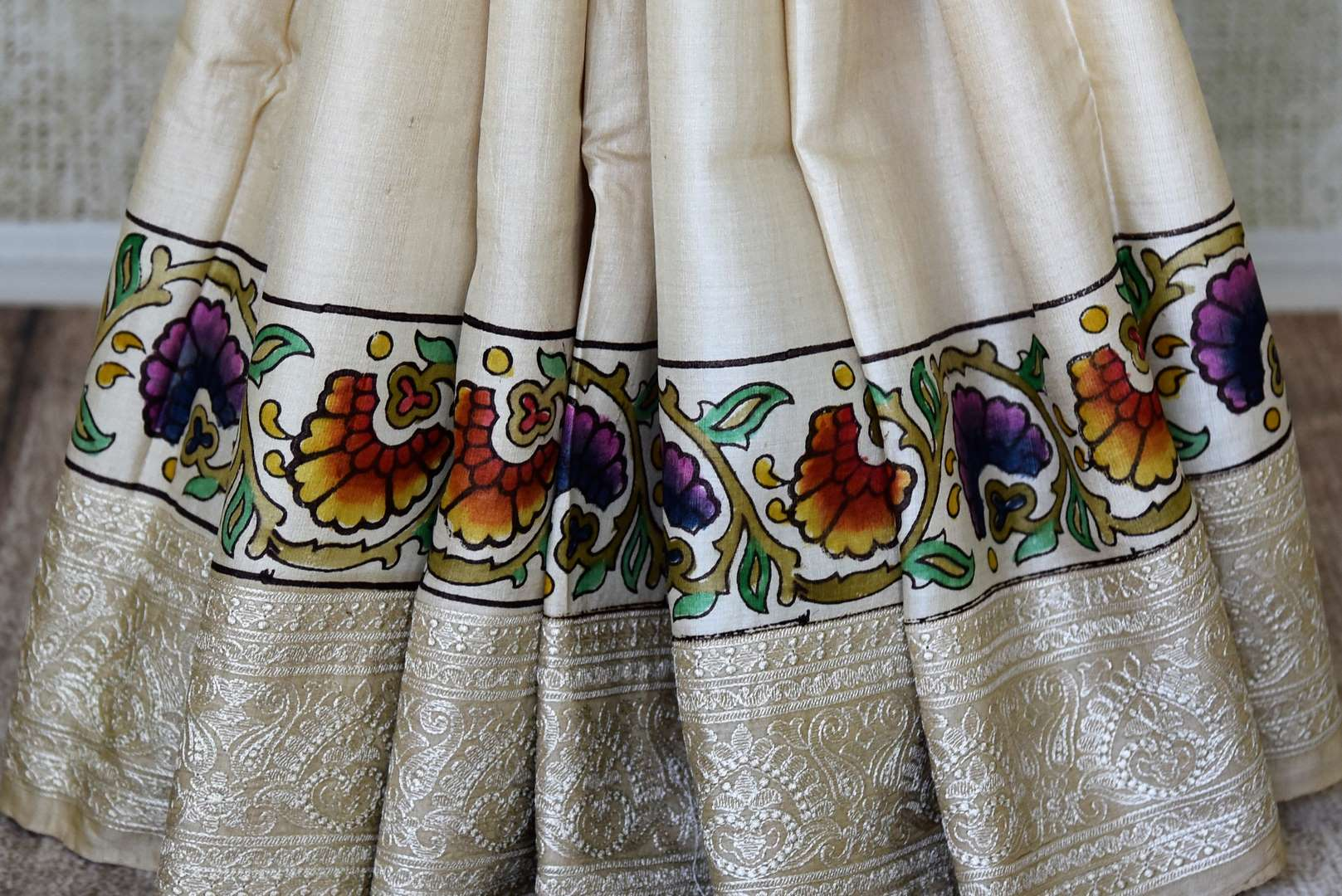 Buy cream tussar silk handprinted and embroidered saree online in USA. Find a splendid collection of Indian designer sarees with blouses in USA at Pure Elegance Indian clothing store. Make a striking appearance on festive occasions by shopping from a range of pure silk saris, Banarasi sarees, embroidered saris from our online store.-pleats